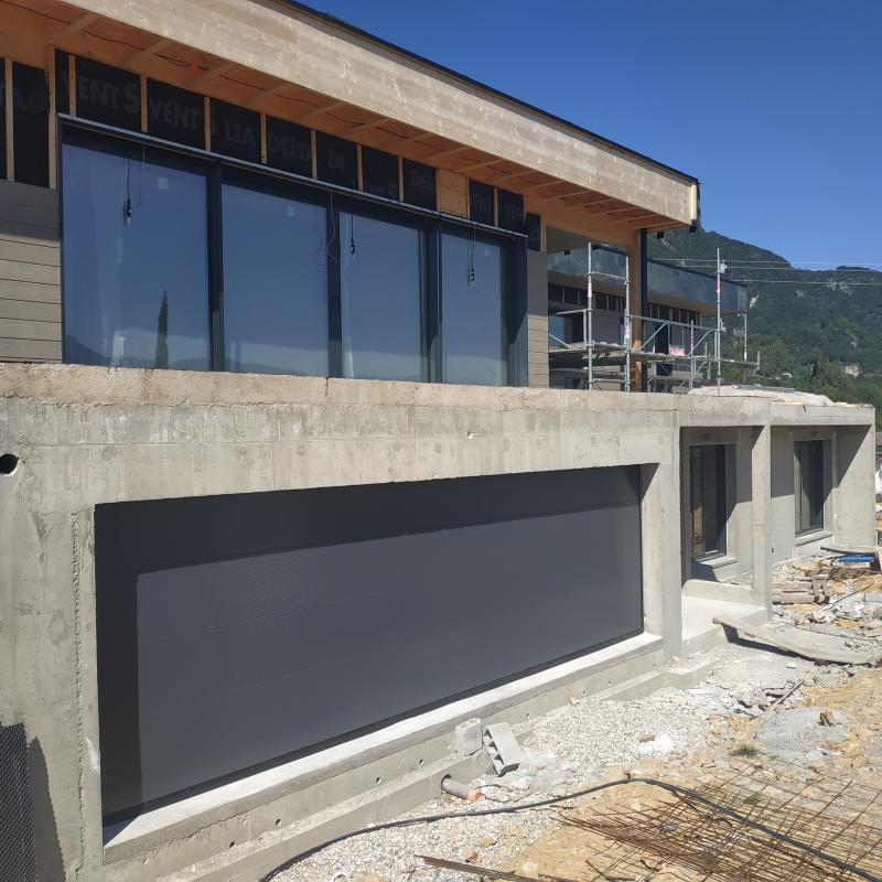 Construction d'une maison ossature bois toit plat au Bourget du Lac en Savoie